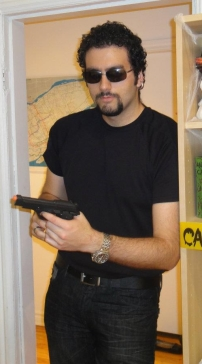 Julian costume with sunglasses and gun