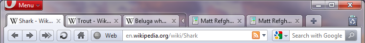 An expanded tab stack, with Shark as the active tab.