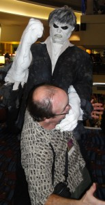 Solomon Grundy attacks a bald man with glasses.