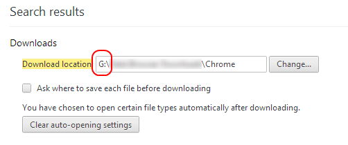 "The ""download location"" field as it appears in the Settings search result page, highlighted. A rounded red rectangle highlights the path's drive letter."