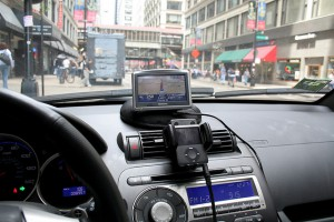 A view of a car's dashboard with both a GPS receiver and iPod set up.